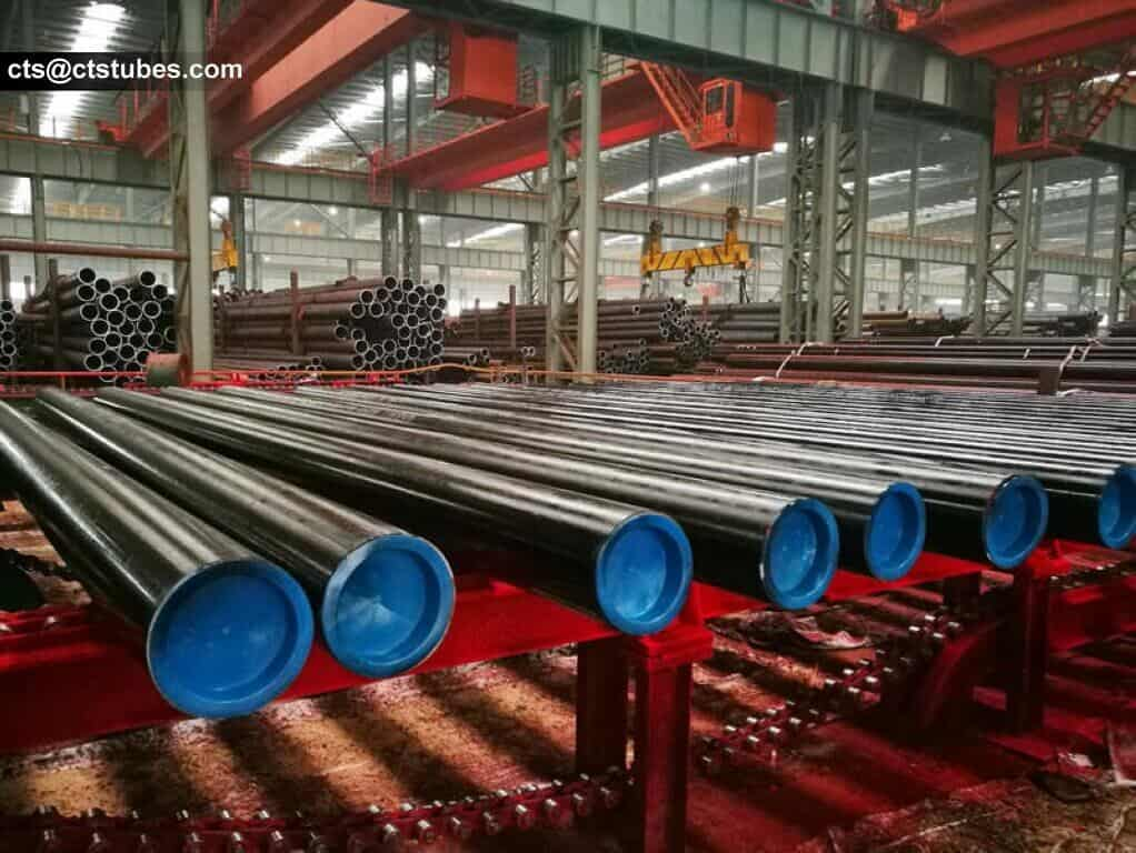 carbon steel tubes with blue caps ready for packaging